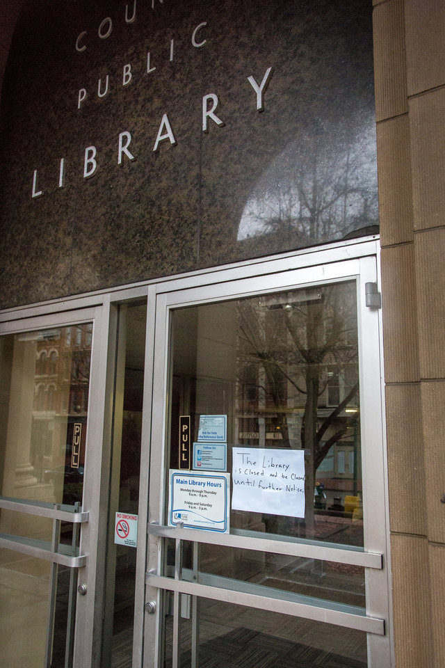 Photo - The Kanawha County Public Library (W.Va.) was forced to close as were other local businesses were forced to stop serving food and drink by the county health department in Charleston, W.Va. on Saturday, Jan. 11, 2014. Coal processing chemicals from Freedom Industries spilled into the Elk River on Thursday. A handful of people have been hospitalized since the spill. (AP Photo/Michael Switzer)