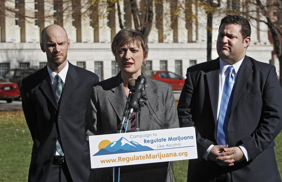 Betty Aldworth, center, a director of the Yes on 64 campaign responds to questions about the legalization of marijuana at a news conference at Civic Center Park in Denver on Wednesday, Nov. 7, 2012. Co-directors Brian Vicente, left, and Mason Tvert, right, listen. Colorado voters passed Amendment 64 on Tuesday legalizing marijuana in Colorado for recreational use. (AP Photo/Ed Andrieski)