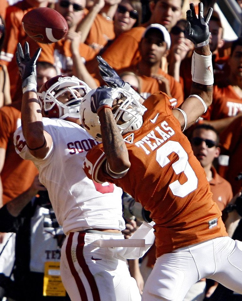 Photo - Texas' Curtis Brown (3) breaks up a pass for Oklahoma's Cameron Kenney (6) during the Red River Rivalry college football game between the University of Oklahoma Sooners (OU) and the University of Texas Longhorns (UT) at the Cotton Bowl in Dallas, Texas, Saturday, Oct. 17, 2009. Photo by Chris Landsberger, The Oklahoman