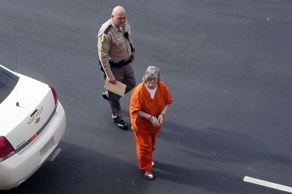 Photo -  Murder defendant Beverly Sue Noe is brought Monday to the Creek County Courthouse in Sapulpa for a preliminary hearing. Photo by Stephen Pingry, Tulsa World