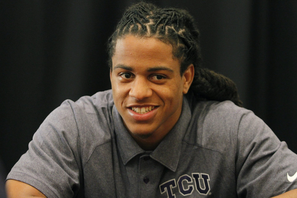 TCU cornerback Jason Verrett conducts interviews during a breakout session at the Big 12 Conference Football Media Days Monday, July 22, 2013 in Dallas.  (AP Photo/Tim Sharp)