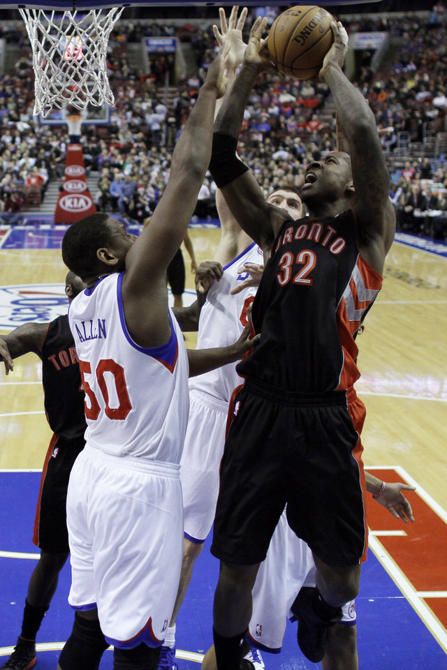 Toronto Raptors' Ed Davis, right, goes up for a shot against Philadelphia 76ers' Lavoy Allen in the first half of an NBA basketball game on Friday, Jan. 18, 2013, in Philadelphia. (AP Photo/Matt Slocum)