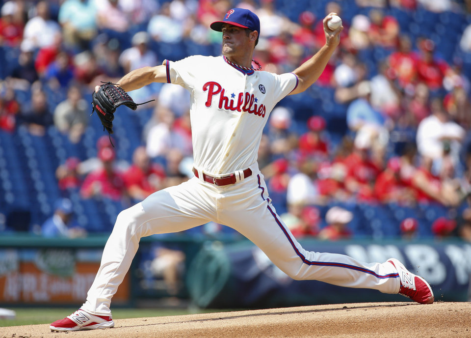 Photo - Philadelphia Phillies starting pitcher Cole Hamels pitches during the first inning of a baseball game against the Seattle Mariners, Wednesday, Aug. 20, 2014, in Philadelphia. (AP Photo/Chris Szagola)