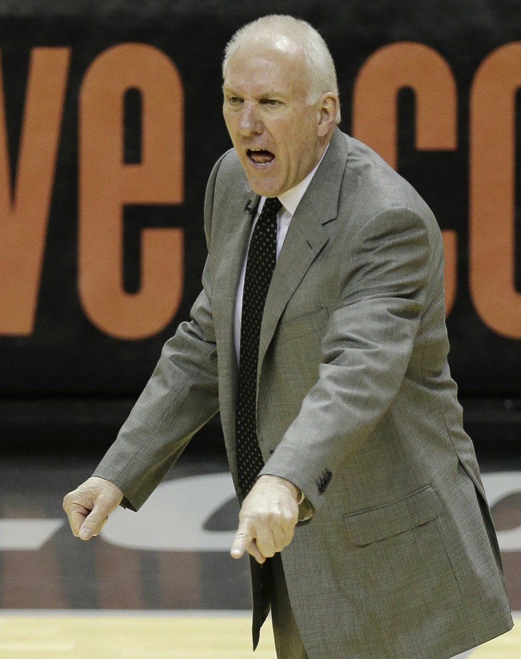 Photo - San Antonio Spurs' Gregg Popovich reacts during the first half at Game 4 of the NBA Finals basketball series against the Miami Heat , Thursday, June 13, 2013, in San Antonio. (AP Photo/David J. Phillip)
