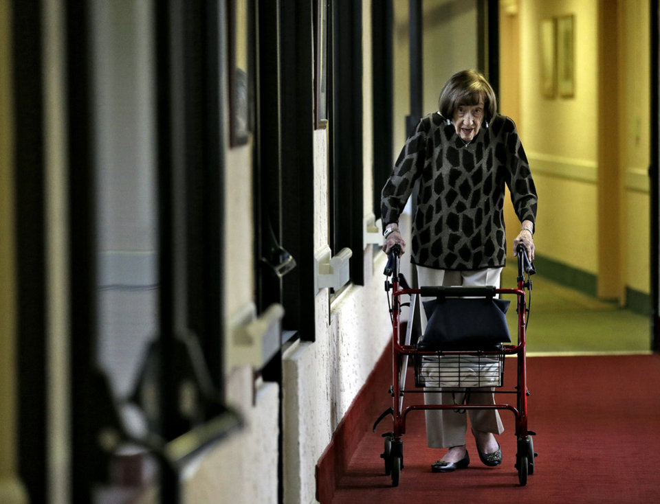 Photo -   Selma Friedman, 102, makes her way through the corridors of her St. Andrew Estates South retirement community on her way to cast her vote early Tuesday, Nov. 6, 2012, in Boca Raton, Fla. Selma, originally from East Orange, N.J., first voted for Franklin Delano Rooosevelt in 1932. (AP Photo/Chris O'Meara)