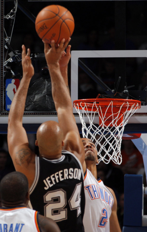 Oklahoma City Thunder's Thabo Sefolosha (2) tries to block San Antonio Spurs' Richard Jefferson (24) shot during the the NBA basketball game between the Oklahoma City Thunder and the San Antonio Spurs at the Chesapeake Energy Arena in Oklahoma City, Sunday, Jan. 8, 2012. Photo by Sarah Phipps, The Oklahoman