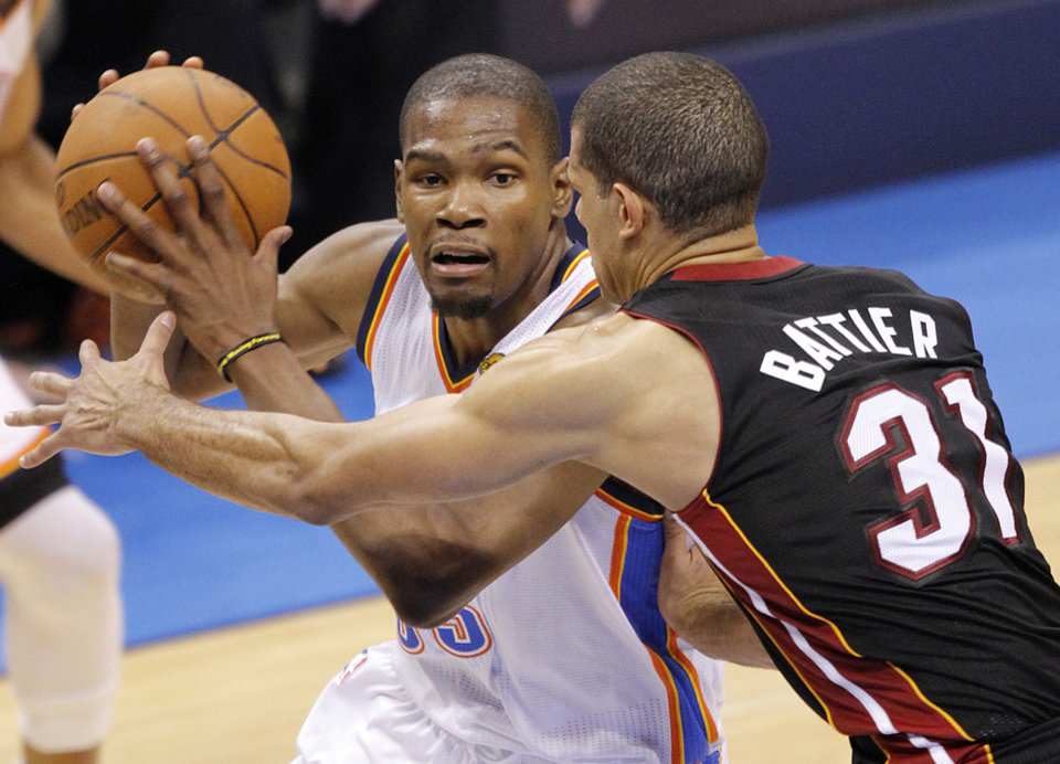 Oklahoma City\'s Kevin Durant (35) drives past Miami\'s Shane Battier (31) during Game 2 of the NBA Finals between the Oklahoma City Thunder and the Miami Heat at Chesapeake Energy Arena in Oklahoma City, Thursday, June 14, 2012. Photo by Chris Landsberger, The Oklahoman