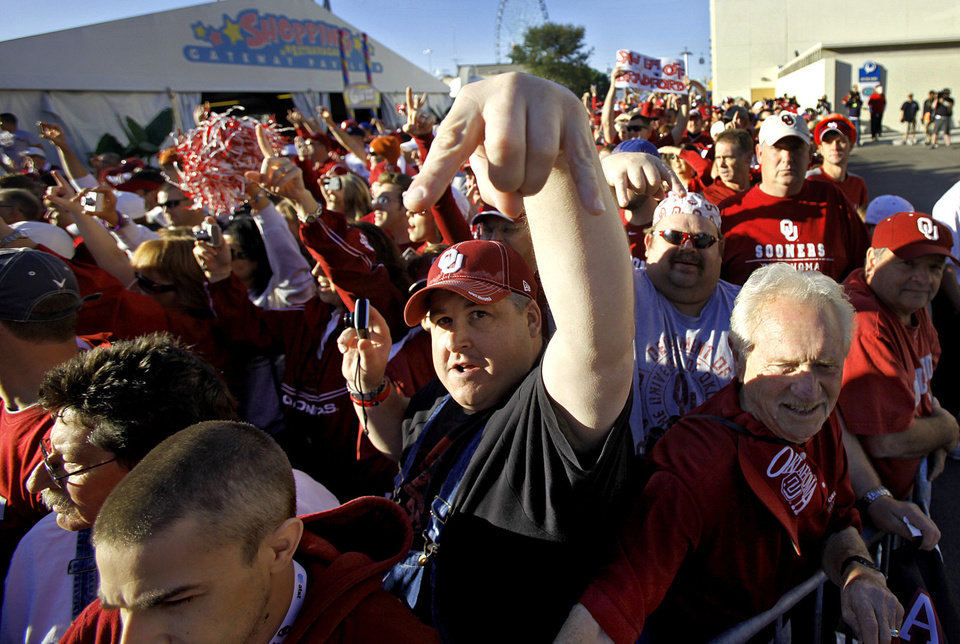 Photo - Sooner fans cheer for their team as the team busses arrive during the Red River Rivalry college football game between the University of Oklahoma Sooners (OU) and the University of Texas Longhorns (UT) at the Cotton Bowl in Dallas, Texas, Saturday, Oct. 17, 2009. Photo by Chris Landsberger, The Oklahoman