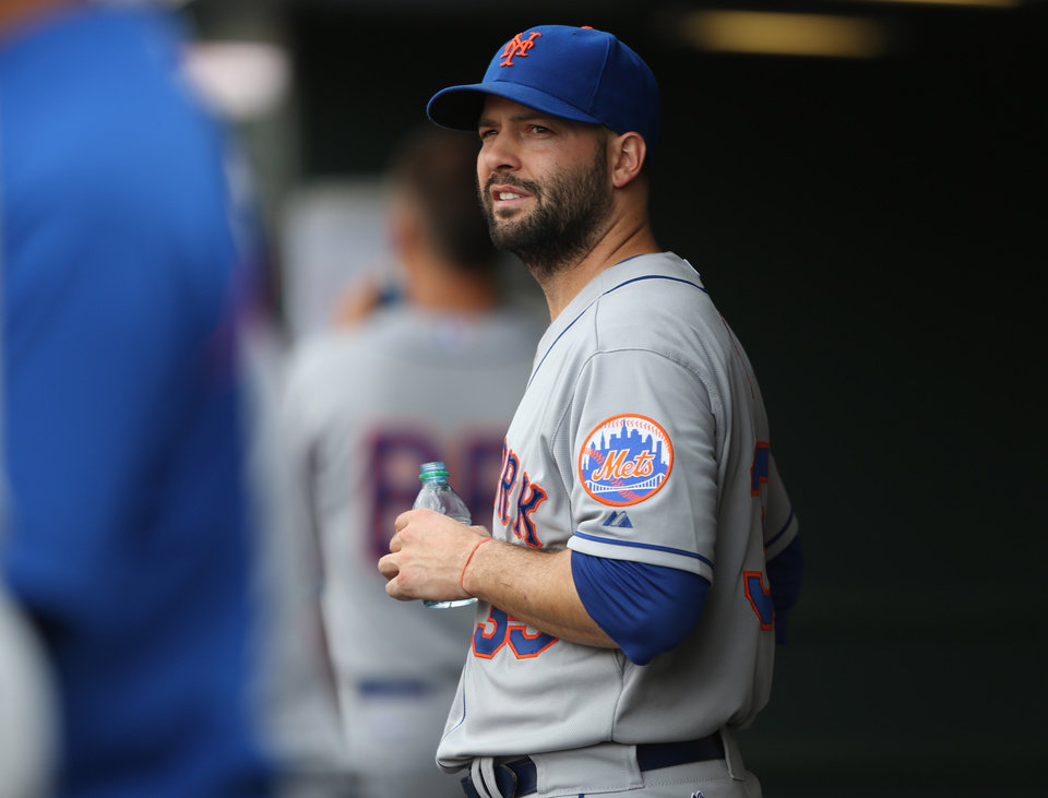 Photo - New York Mets starting pitcher Dillon Gee looks on from the dugout after he was pulled against the Colorado Rockies in the seventh inning of the Mets' 5-1 victory in a baseball game in Denver, Sunday, May 4, 2014. (AP Photo/David Zalubowski)