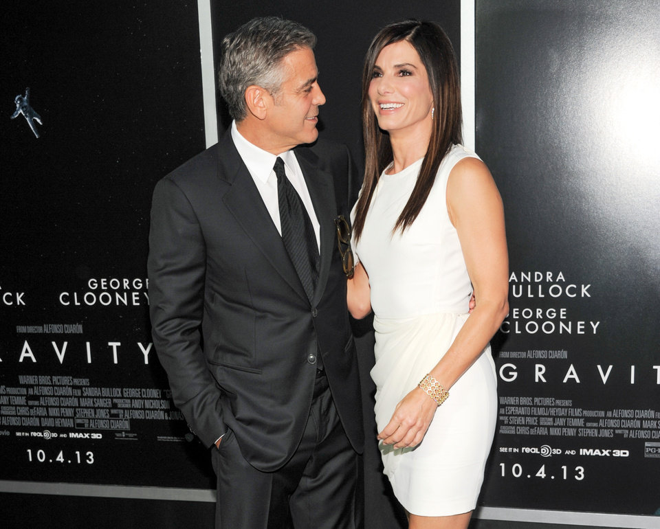 "Actors George Clooney and Sandra Bullock attend the premiere of ""Gravity"" at the AMC Lincoln Square Theaters on Tuesday, Oct. 1, 2013, in New York. (Photo by Evan Agostini/Invision/AP) ORG XMIT: NYEA111"