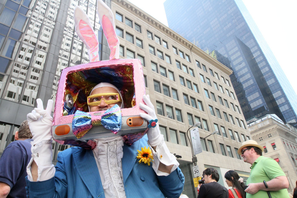 Photo -   Dressed as a rabbit television, Davey Mitchell, of New York, left, poses for photographs as he takes part in the Easter Parade along New York's Fifth Avenue Sunday April 24, 2011. (AP Photo/Tina Fineberg)