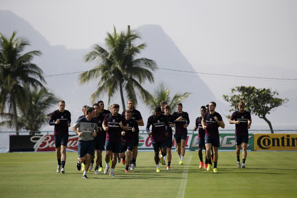 Photo - England national soccer team players take part in a squad training session for the 2014 soccer World Cup at the Urca military base in Rio de Janeiro, Brazil, Wednesday, June 11, 2014.  The England soccer team are staying in Rio de Janeiro as their base city for the 2014 soccer World Cup.  (AP Photo/Matt Dunham)