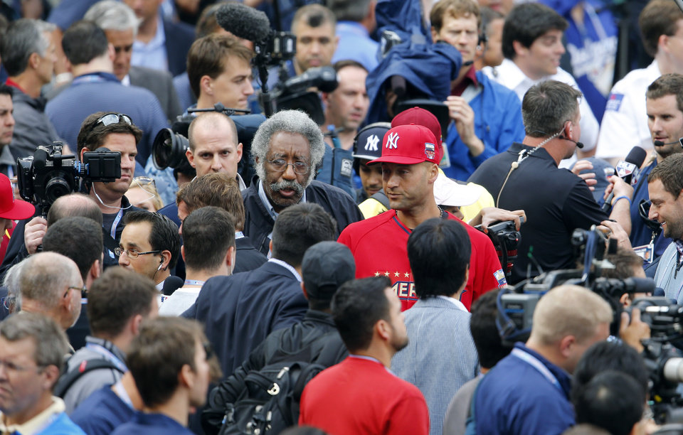 Photo - American League short stop Derek Jeter, of the New York Yankees, center, walks off the field following batting practice for the MLB All-Star baseball game, Monday, July 14, 2014, in Minneapolis. (AP Photo/Paul Sancya)