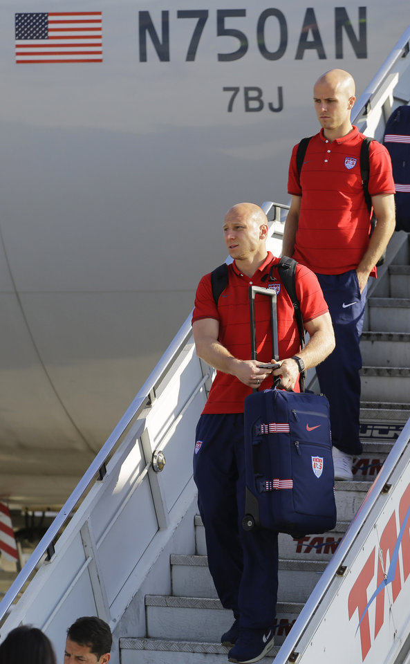 Photo - United States' national soccer team goalkeeper Brad Friedel, bottom, and Michael Bradley arrives at the Sao Paulo International airport in Brazil, Monday, June 9, 2014. The U.S. team arrived in Sao Paulo to continue their preparations for the upcoming Brazil 2014 World Cup, which starts on June 12. (AP Photo/Nelson Antoine)