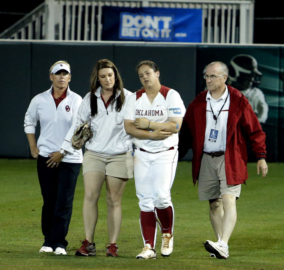 Photo - Oklahoma's Brittany Williams leaves the field with an injury in the seventh inning as the University of Oklahoma Sooner (OU) softball team plays Tennessee in the first game of the NCAA super regional at Marita Hynes Field on May 23, 2014 in Norman, Okla. Photo by Steve Sisney, The Oklahoman