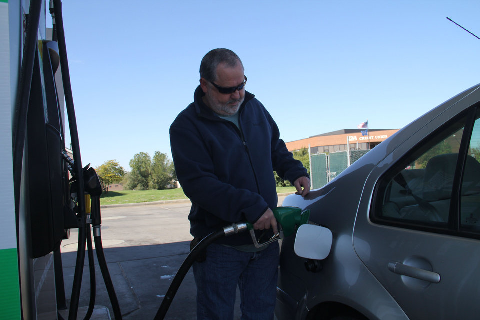 Jesse Staley of Moore on Friday filled up his 2002 diesel-powered Volkswagen Jetta at the Murphy USA station at 104th and South Western for $3.85 a gallon even as regular unleaded gasoline was selling for $2.95.  The average price of gasoline in Oklahoma City has dropped 50 cents over the past month. <strong>Adam Wilmoth - photo by</strong>