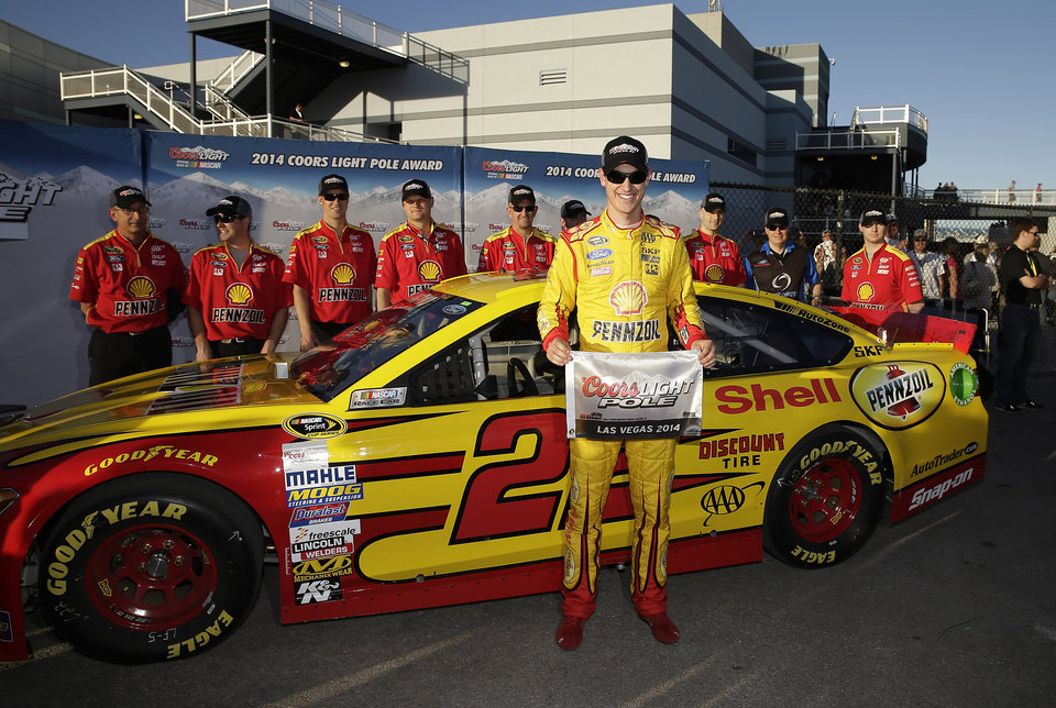 Photo - Joey Logano poses for photos after winning the pole position for Sunday's NASCAR Sprint Cup Series auto race, Friday, March 7, 2014, in Las Vegas. (AP Photo/Isaac Brekken)