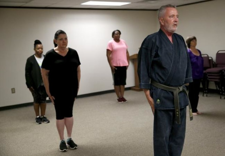 Photo - Terry Smith, construction project manager at the Office of Juvenile Affairs, teaches self-defense class in Oklahoma City, Thursday, Aug. 8, 2019. [Sarah Phipps/The Oklahoman]