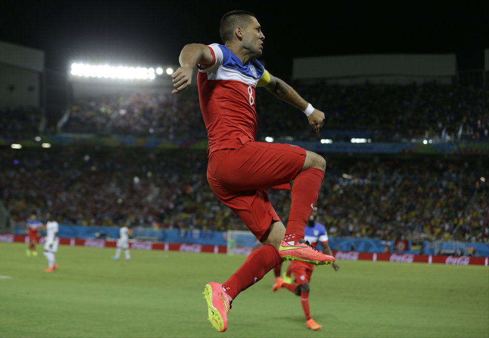 Photo - United States' Clint Dempsey leaps as he celebrates after scoring the opening goal during the group G World Cup soccer match between Ghana and the United States at the Arena das Dunas in Natal, Brazil, Monday, June 16, 2014.  (AP Photo/Ricardo Mazalan)