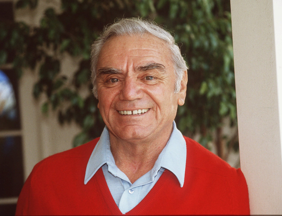 Photo - FILE-- Actor Ernest Borgnine is shown in this 1984 file photo.   Borgnine is being recalled to duty in ``McHale's Navy'', this time, as an admiral.  Borgnine, who as Lt. Cmdr. Quinton McHale led a World War II PT boat with a crew of misfits, is starring in a movie version of the 1960s TV series.  Today, viewers know Borgnine, 79, as the friendly doorman Manny on the sitcom ``Single Guy.'' (AP Photo/File)