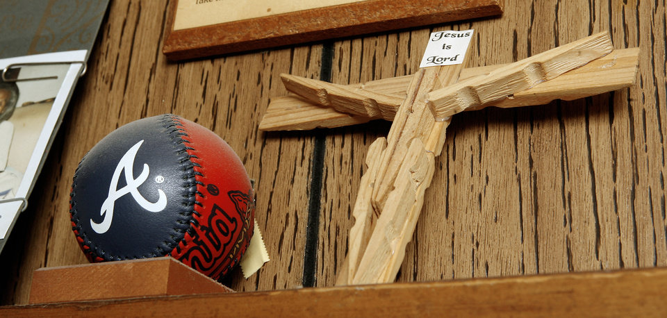 An A's baseball and cross on a shelf in the bedroom of Oklahoma City resident Robert Jones, 103, at his home Thursday, Nov. 6, 2008, while talking about this week's presidential election. BY PAUL B. SOUTHERLAND, THE OKLAHOMAN