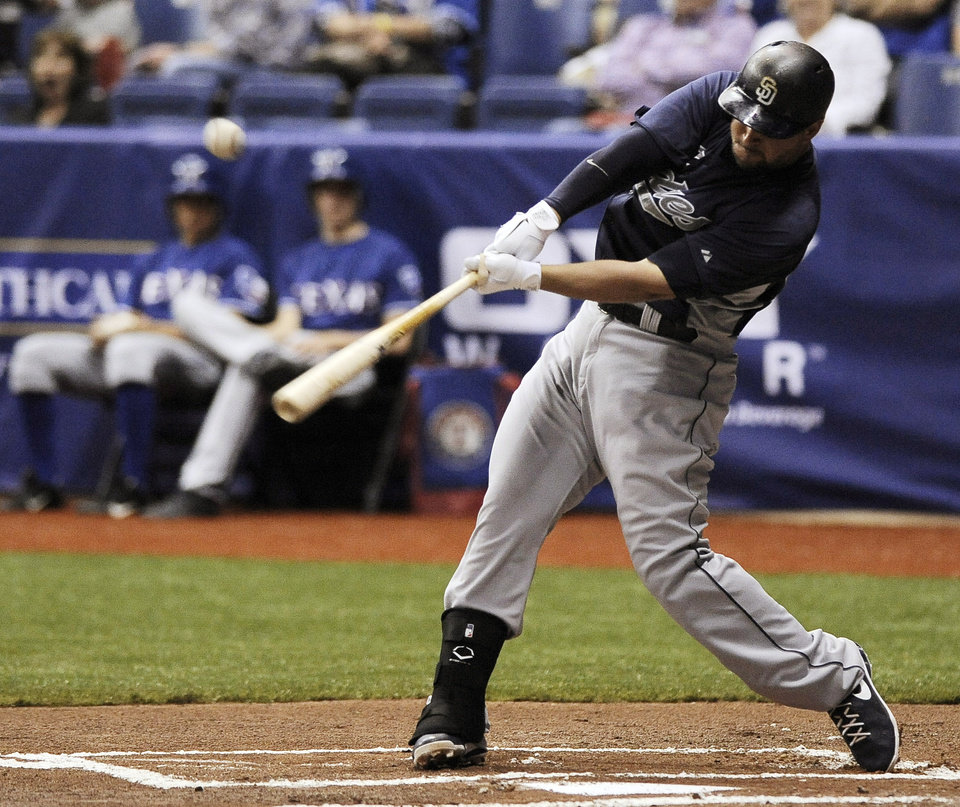 San Diego Padres' Yonder Alonso swings at a pitch during an exhibition baseball game against the Texas Rangers, Saturday, March 30, 2013, at the Alamodome in San Antonio. Texas won 5-2. (AP Photo/Darren Abate)
