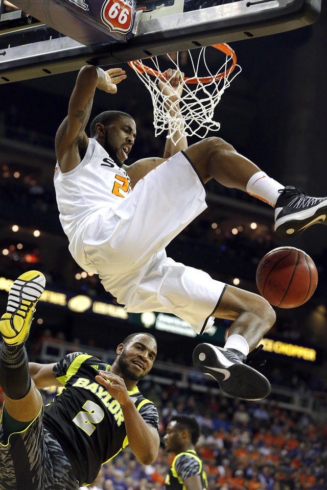 Oklahoma State's Michael Cobbins (20)  dunks over Baylor's Rico Gathers (2) during the Phillips 66 Big 12 Men's basketball championship tournament game between Oklahoma State University and Baylor at the Sprint Center in Kansas City, Thursday, March 14, 2013. Photo by Sarah Phipps, The Oklahoman
