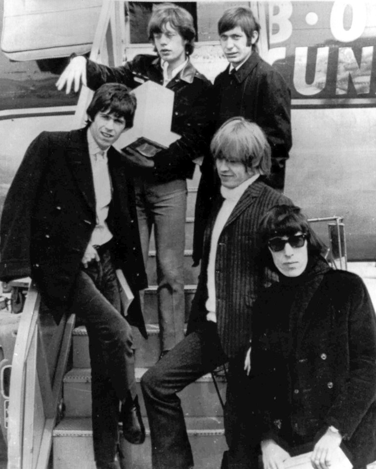 "Photo - FILE - In this April 22, 1965 file photo, British rock and roll group, The Rolling Stones, arrive at Montreal Airport. They are Mick Jagger, top left, Charlie Watts, top right, Keith Richards, middle left, Brian Jones, middle right, and Bill Wyman. The Cleveland-based The Rock and Roll Hall of Fame Museum will open ""Rolling Stones: 50 Years of Satisfaction,"" an exclusive exhibit celebrating the archetypal rock band, on May 24, 2013. (AP Photo, File)"