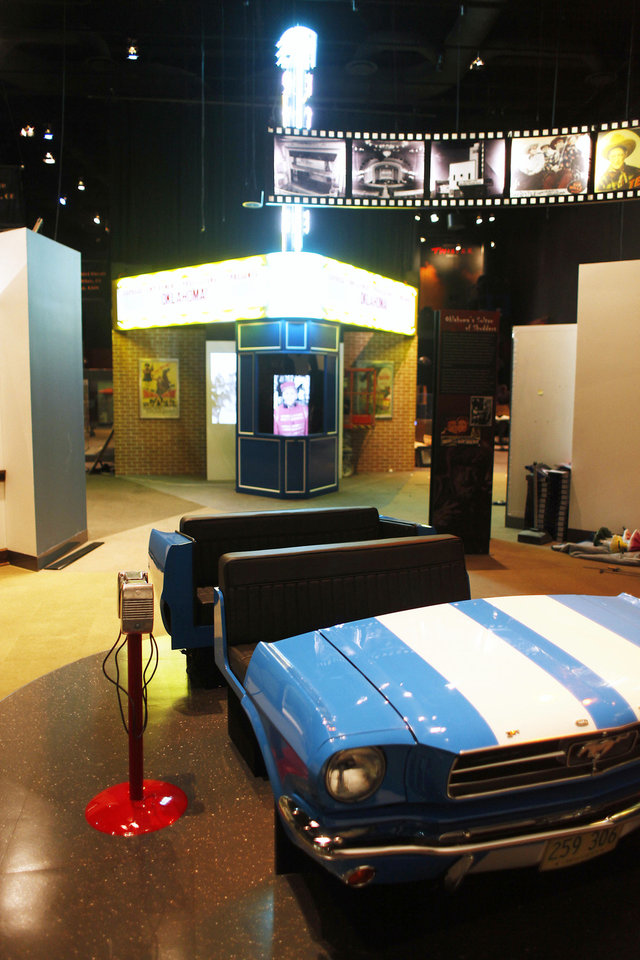 Photo - Displays at the Oklahoma @ The Movies exhibit at the Oklahoma History Center Friday, May 4, 2012. Photo by Doug Hoke, The Oklahoman