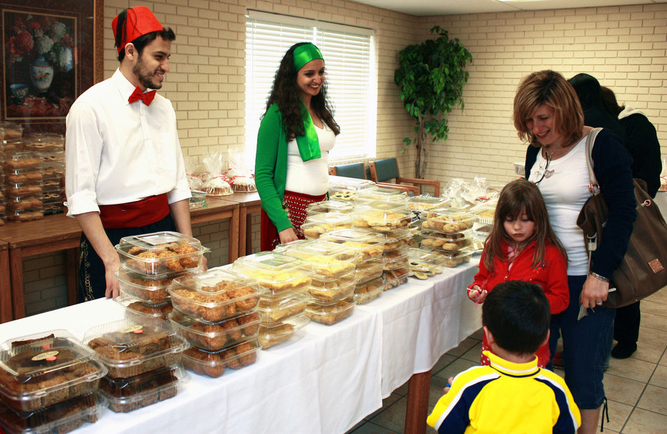 Photo - Children and adults line up for treats at the Lebanese heritage festival at Our Lady of Lebanon Maronite Catholic Church. PHOTO BY LYNETTE LOBBAN, FOR THE OKLAHOMAN