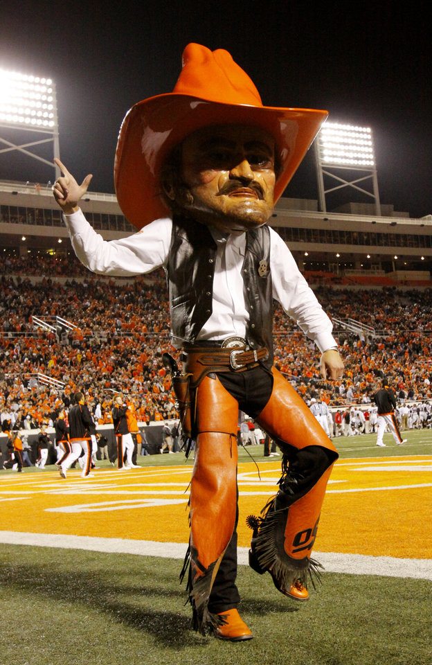 Photo - Pistol Pete fires up the crowd during the college football game between Oklahoma State University (OSU) and Texas Tech University at Boone Pickens Stadium in Stillwater, Okla. Saturday, Nov. 14, 2009. Photo by Doug Hoke, The Oklahoman