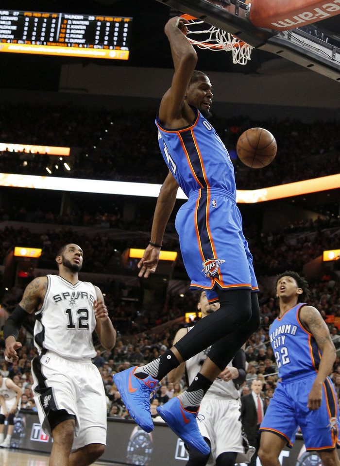 Photo - Oklahoma City's Kevin Durant (35) dunks the ball as San Antonio's LaMarcus Aldridge (12) watches during Game 2 of the second-round series between the Oklahoma City Thunder and the San Antonio Spurs in the NBA playoffs at the AT&T Center in San Antonio, Monday, May 2, 2016. Photo by Bryan Terry, The Oklahoman