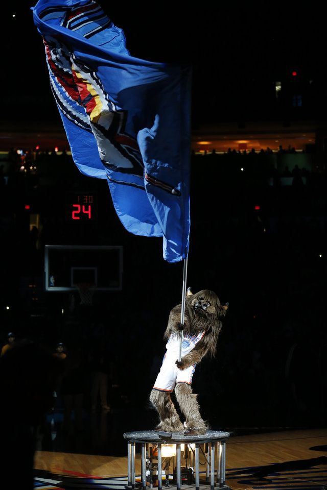 Photo - Thunder mascot Rumble waves a Thunder flag as the Oklahoma City Thunder play the Atlanta Hawks in NBA basketball at the Chesapeake Energy Arena in Oklahoma City, on Sunday, Nov. 4, 2012.  Photo by Steve Sisney, The Oklahoman