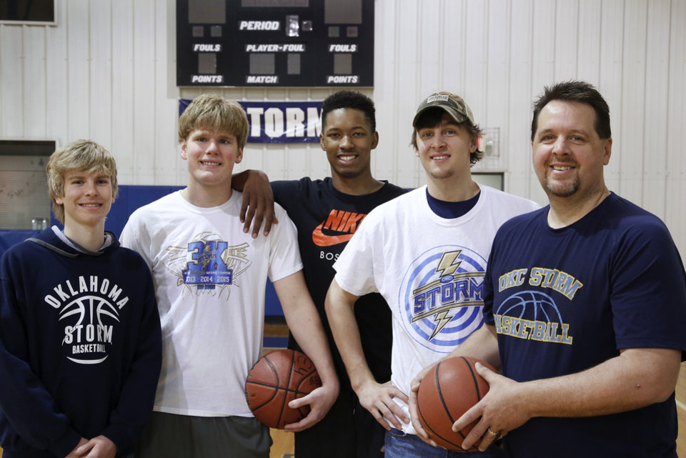 Photo - From left, basketball players Tanner Fike, Mark Malone, Tevin Townsend, Kole Talbott and Coach Kurt Talbott pose for a photograph in the gym at the Church of the Harvest in northeast Oklahoma City on Monday, March 16, 2015. Oklahoma City Storm homeschool basketball team won another national title over the weekend. But it was what they did at the end of their blowout victory in the title game that has folks buzzing. The Storm enabled a disabled player from the opposing team to get to the free throw line and score a couple points. They Photo by Jim Beckel, The Oklahoman