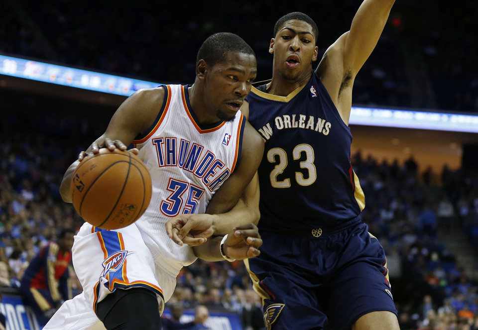 Photo - OKC's Kevin Durant drives toward the lane during the Thunder's preseason matchup against Anthony Davis and the New Orleans Pelicans, at the BOK Center, on Thursday, Oct. 17, 2013. CORY YOUNG/Tulsa World ORG XMIT: DTI1310172151212823