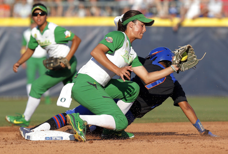 Photo - Florida's Kelsey Stewart (7) steals 2nd base against Oregon's Nikki Udria (3) in the 3rd inning during Game 5 of the Women's College World Series softball tournament between Florida and Oregon at ASA Hall of Fame Stadium in Oklahoma City, Friday, May 30, 2014. Photo by Nate Billings, The Oklahoman