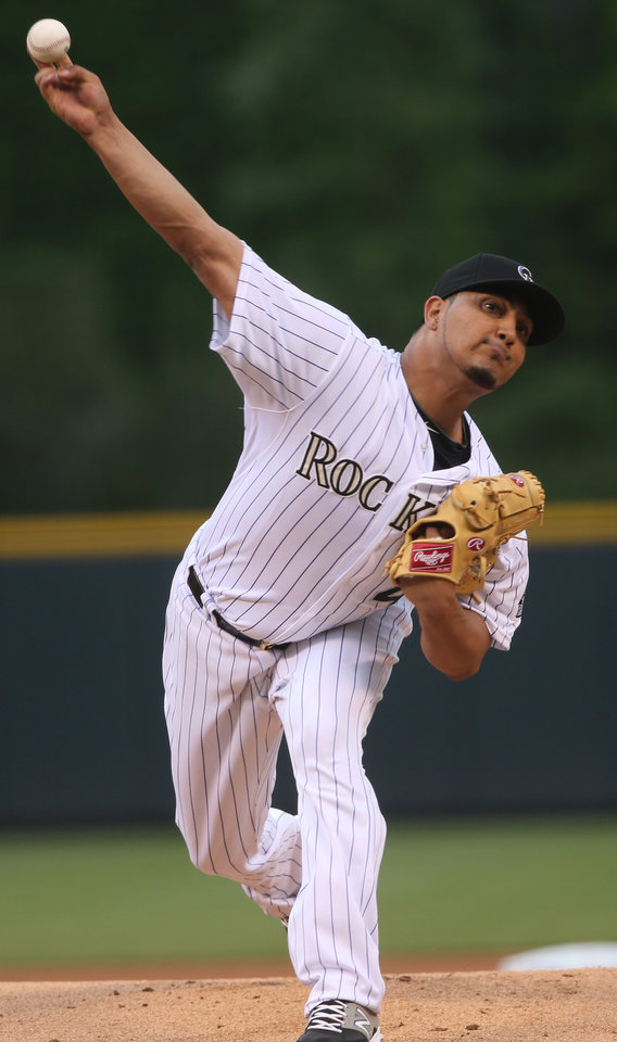 Photo - Colorado Rockies starting pitcher Jhoulys Chacin works against the San Francisco Giants in the first inning of a baseball game in Denver on Wednesday, May 21, 2014. (AP Photo/David Zalubowski)
