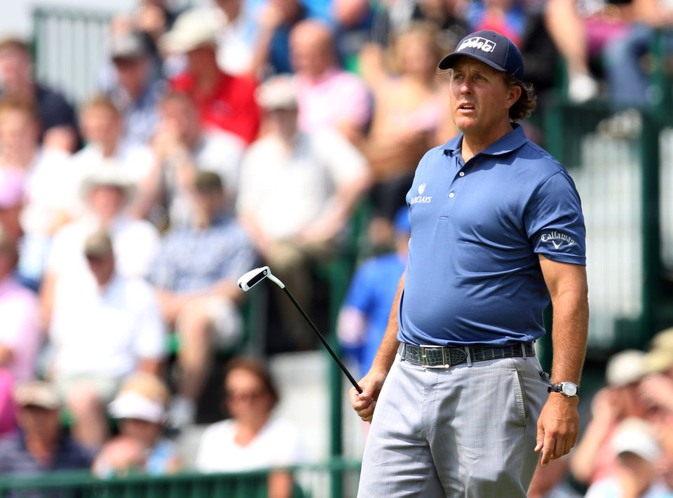 Photo - Phil Mickelson of the US watches his putt on the 12th green during the second day of the British Open Golf championship at the Royal Liverpool golf club, Hoylake, England, Friday July 18, 2014. (AP Photo/Scott Heppell)