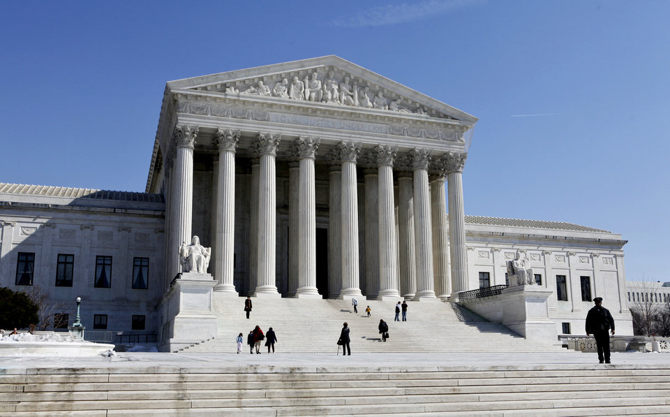 Photo - FILE- This March 5, 2009, file photo shows the U.S. Supreme Court building in Washington. The Supreme Court will struggle this week with the validity of an Arizona law that tries to keep illegal immigrants from voting by demanding all state residents show documents proving their U.S. citizenship before registering to vote in national elections.  (AP Photo/J. Scott Applewhite, File)