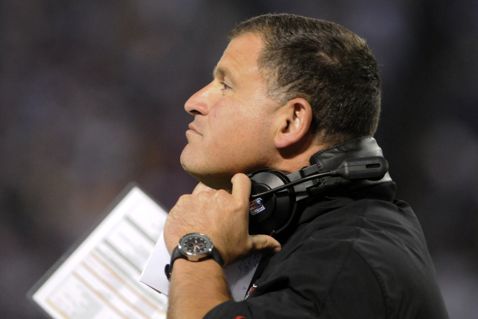 Photo -   Tampa Bay Buccaneers head coach Greg Schiano watches during the first half of an NFL football game against the Minnesota Vikings, Thursday, Oct. 25, 2012, in Minneapolis. (AP Photo/Jim Mone)