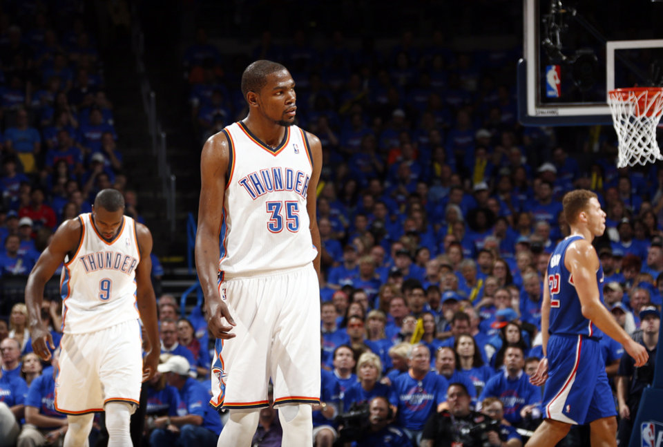 Oklahoma City\'s Kevin Durant (35) and Serge Ibaka (9) react to a play as Los Angeles\' Blake Griffin (32) walks to the bench during Game 1 of the Western Conference semifinals in the NBA playoffs between the Oklahoma City Thunder and the Los Angeles Clippers at Chesapeake Energy Arena in Oklahoma City, Monday, May 5, 2014. Photo by Sarah Phipps, The Oklahoman