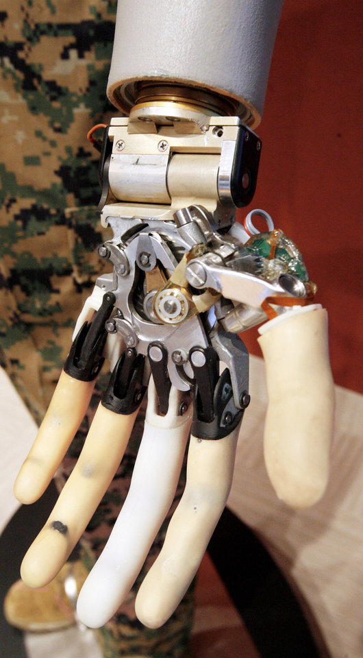 A robotic hand is demonstrated at a technology briefing.PHOTO BY PAUL B. SOUTHERLAND, THE OKLAHOMAN
