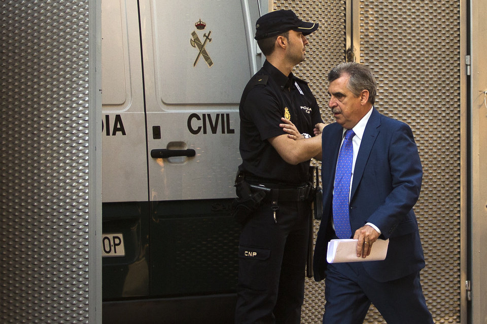 Photo - Judge Ismael Moreno, right, in charged of Ashya King case arrives to the National court in Madrid, Spain, Monday, Sept. 1, 2014. A critically-ill 5-year-old boy driven to Spain by his parents against doctors' advice is receiving medical treatment for a brain tumor in a Spanish hospital as his parents await extradition to Britain, police said Sunday. Officers received a phone call late Saturday from a hotel east of Malaga advising that a vehicle fitting the description circulated by police was on its premises. Both parents were arrested and the boy, Ashya King, was taken to a hospital, a Spanish police spokesman said. (AP Photo/Andres Kudacki)