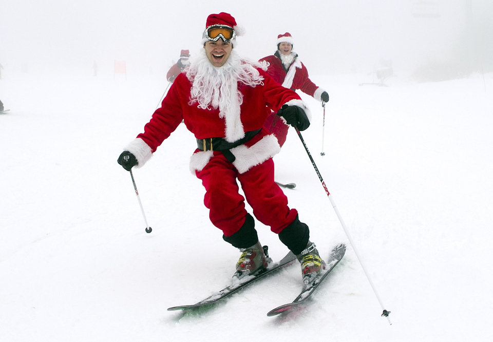 A man dressed as Santa skiis down the slopes at the Sunday River Ski Resort in Newry, Maine, Sunday, Dec. 2, 2012. More than 250 Santas participated in the annual event to raise money to benefit the Bethel Rotary Club's Christmas for Children program. (AP Photo/Robert F. Bukaty)
