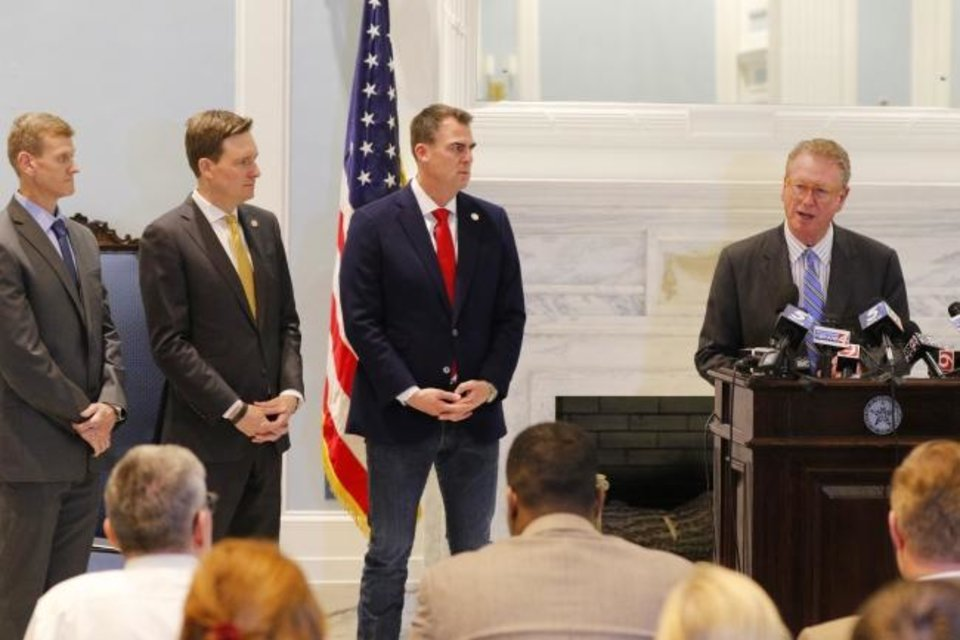 Photo -  Commissioner of Health, Gary Cox speak as Oklahoma government officials have a press conference to discuss the state's response to the Covid-19 Thursday, March 12, 2020.  [Photo by Doug Hoke/The Oklahoman]
