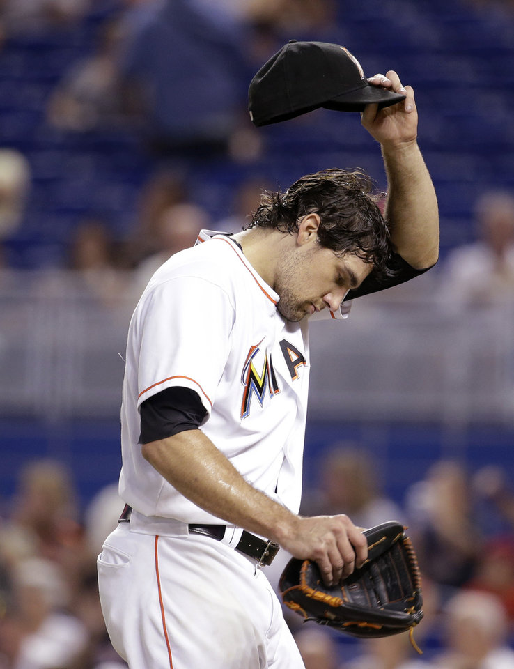 Photo - Miami Marlins starting pitcher Nathan Eovaldi walks to the dugout after pitching in the first inning during a baseball game against the St. Louis Cardinals, Wednesday, Aug. 13, 2014, in Miami. (AP Photo/Lynne Sladky)