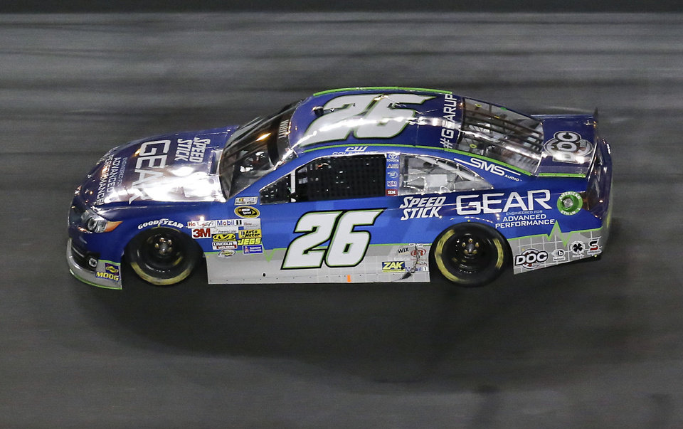 Photo - Cole Whitt drives his car down the front stretch during the first of two NASCAR Sprint Cup qualifying auto races at Daytona International Speedway in Daytona Beach, Fla., Thursday, Feb. 20, 2014. (AP Photo/John Raoux)