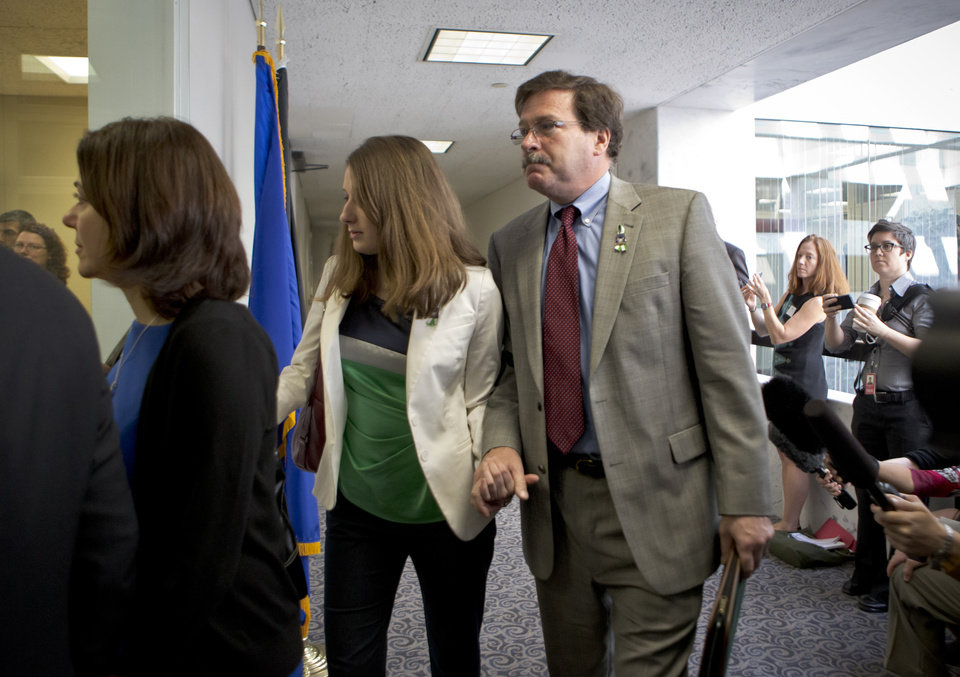 Photo - Bill Sherlach, with daughter Maura Lynn Schwartz, arrives with other families of the Newtown, Connecticut, school massacre to meet privately on Capitol Hill in Washington, Tuesday, April 9, 2013, with Sen. Richard Blumenthal, D-Conn., and Sen. Chris Murphy, D-Conn. His wife, Mary Sherlach, was a school psychologist who was killed during a mass shooting that left 26 people dead at Sandy Hook Elementary School in December 2012.   (AP Photo/J. Scott Applewhite)