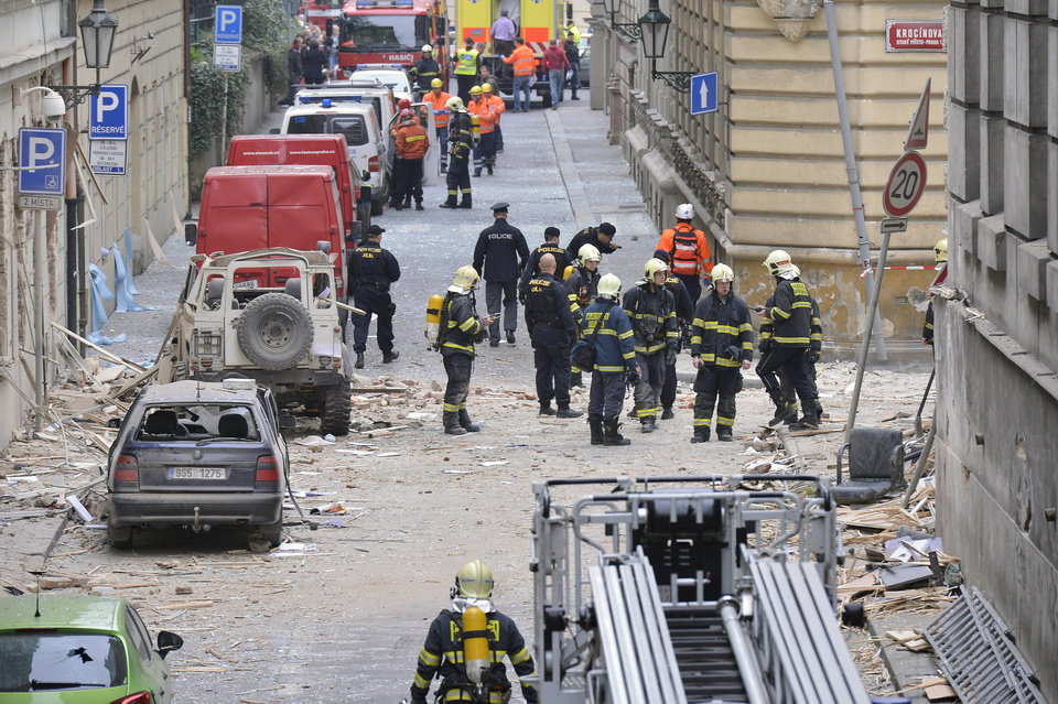Photo - Firefighters and rescue workers work at the scene of a strong blast in a building in the center of Prague, Czech Republic, in the morning on Monday, April 29, 2013.  A powerful explosion badly damaged an office building in the center of the Czech capital Monday, injuring up to 40 people. Authorities believe people may still be buried in the rubble.  (AP Photo/CTK, Michal Dolezal)