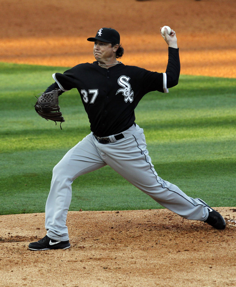 Photo - Chicago White Sox pitcher Scott Downs delivers during a spring exhibition baseballgame against the Birmingham Barons on Friday, March 28, 2014, in Birmingham, Ala. (AP Photo/Butch Dill)